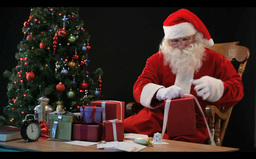 Timelapse Of Santa Wrapping Gifts stock footage