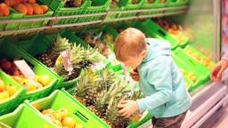 Boy choosing pineapple Footage