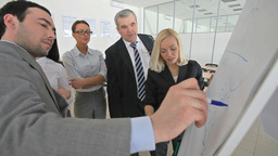 Business Team Analyzing Financial Data Footage