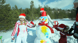 Family Dancing Around Snowman Footage