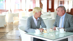 Dolly Shot OF Senior Couple In Café Footage