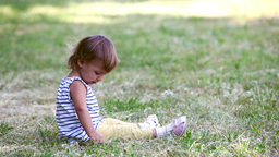 Child On The Grass stock footage