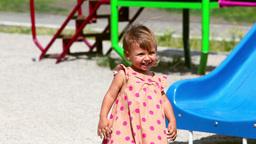 Little Girl Sliding Down Chute Footage