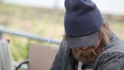 Homeless Man Caressing A Little Kitten Footage
