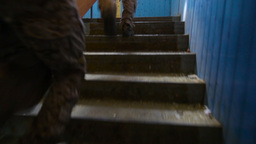 Military Group Running Up The Staircase In An Abandoned House, Faded Footage