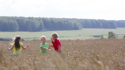 Children Trying To Outrun Each Other In The Countryside, Boys Being Rivals Footage
