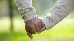 Close-Up Of An Elderly Couple Holding Hands And Walking Together Footage