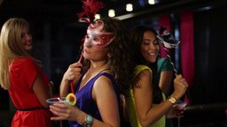 Girls In Masks Partying When Their Friend Fires A Petard With Confetti Footage