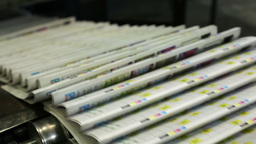 Close-Up Of A Conveyor Carrying Numerous Freshly Printed Newspapers Footage
