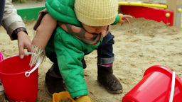 Cute Kid Playing In The Sandbox Together With Her Mom Footage