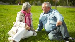 Senior Couple Enjoying Their Leisure On The Lawn Footage