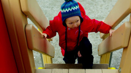 Children Spending Time On The Playground Climbing Up The Stairs Footage