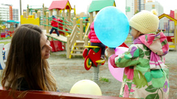 Little Girl Hiding Behind Colorful Balloons Playing With Her Mom Footage