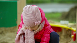 Close-Up Of A Cutie Playing In A Sandpit Footage