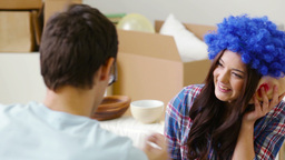 Girl Wearing Blue Wig And Guy With Huge Eyes Having A Moment Of Fun While Moving Footage