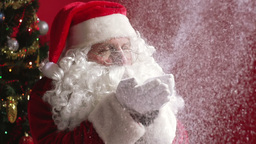 Close-up of Santa Claus celebrating Christmas and blowing Animation
