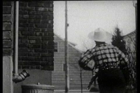 A boy dressed as a cowboy lassos a loaf of Sunbeam Footage