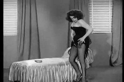 A 1950s burlesque dancer strips for an audience Footage