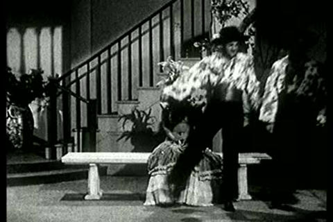 Exotic dance number from the 1940s featuring Latin Footage