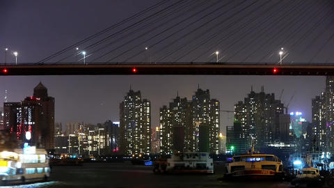 time lapse,Brightly lit ships on river at night,across the sea bridge,urban Animation