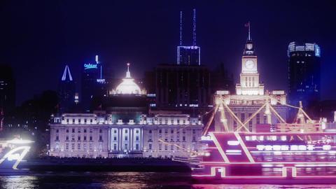 time lapse,Brightly lit ships cruising Shanghai Bund at night,old building Animation