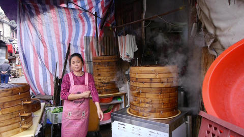 Typical chinese bun stand,a woman count the money,fresh buns with steam Animation