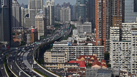 heavy traffic on highway interchange,Shanghai business building skyline Animation
