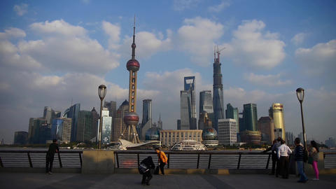 Shanghai Lujiazui financial center,Tourists play in huangpu river bund Animation