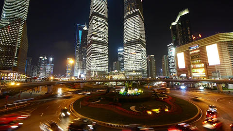 time lapse urban traffic at night,Brightly lit shanghai pudong building Animation