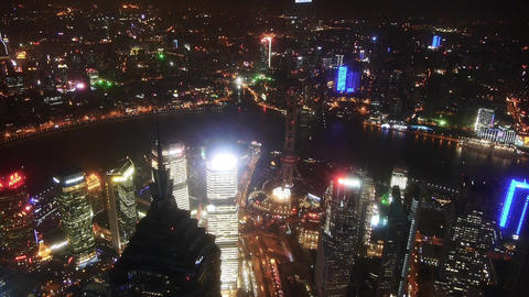 aerial view of high-rise buildings with river in Shanghai at night,China,time la Animation