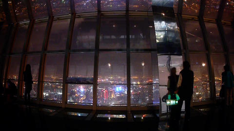 Tourists aerial view of Shanghai night-scene in huanqiu sightseeing hall Animation