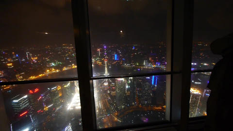 a man aerial view of Shanghai night-scene from skyscrapers windows Animation
