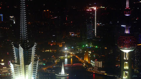 aerial view of skyscraper rooftop crown at night,shipping & urban traffic Animation
