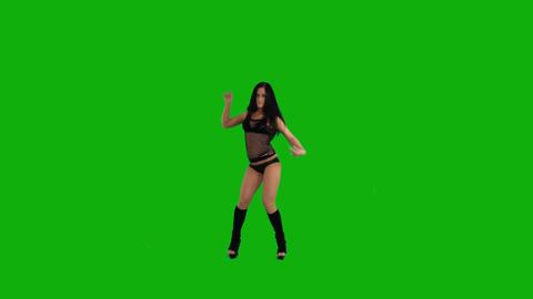 Beautiful young woman dancing against green screen Footage