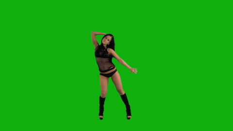 Beautiful young woman dancing against green screen 影片素材