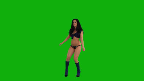 Beautiful young woman dancing against green screen Stock Video Footage