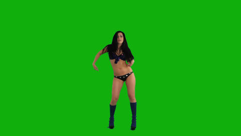 Beautiful young woman dancing against green screen Footage