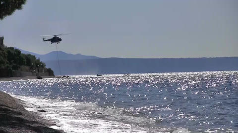 Chopper In Action At Sea stock footage