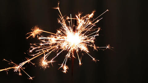 sparkler burning on dark background Live Action