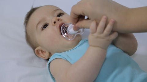 Baby With Pacifier stock footage