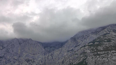 Clouds Over Mountain Timelapse stock footage