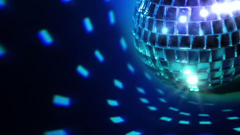 Dark background and disco ball. Seamless loop Footage