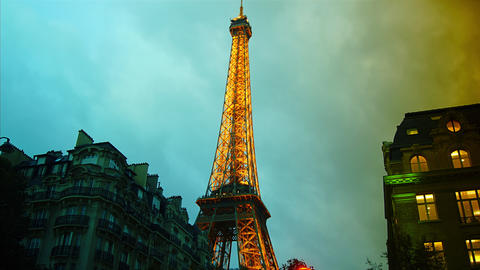 4k, The amazing Eiffel Tower lights up at fixed ho Footage