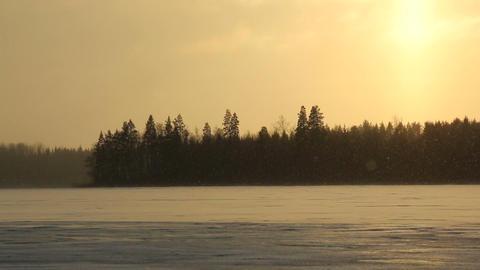 Snowing on windy lake Footage