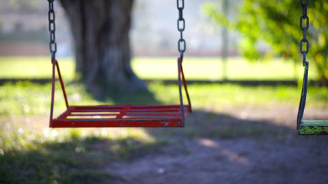Empty swing in a children's playground Footage