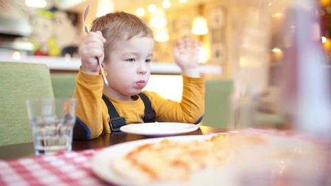 Little Boy In Cafe stock footage