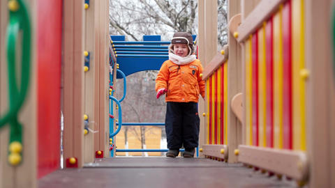 Little boy on playground equipment Footage