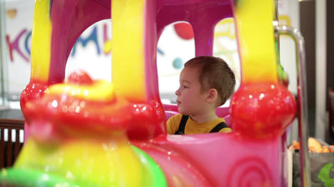 Boy In Amusement Train stock footage