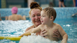 Grandmother and a grandson in the swimming pool Footage
