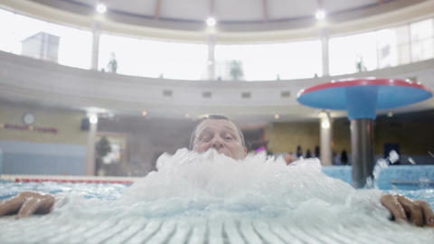 Man In The Swimming Pool stock footage